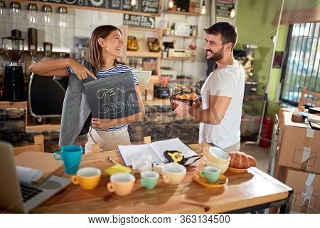 young couple opening cafe of their own. enthusiastic, startup business