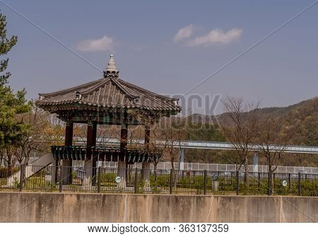 Jinan, South Korea; April 21, 2020: Large Colorful Oriental Pavilion In Rural Park At Yongdam Dam Re