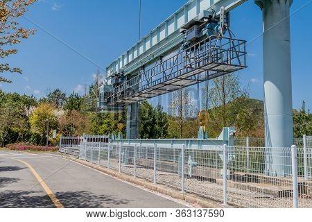 Jinan, South Korea; April 21, 2020: Yongdam Dam Spillway Hoist Gate Deck Under Blue Sky.
