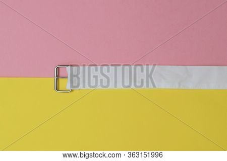 A White Belt With A Metal Buckle Separates The Yellow And Red Areas Of The Image. Womens Accessory.
