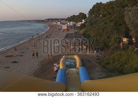 Sevastopol, Crimea, Russia - July 28, 2019: Children Ride An Inflatable Slide On The Uchkuevka Beach