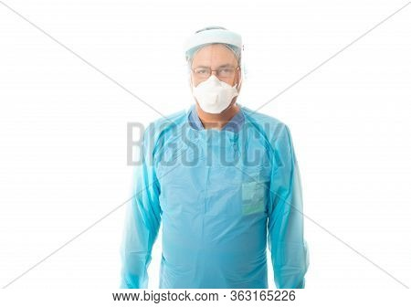 Male Healthcare Worker In Protective Ppe Gown, N95 Respirator Mask And Face Shield