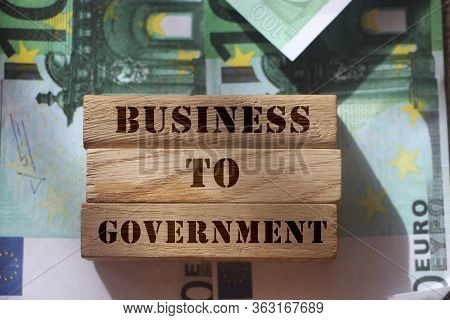 Business To Government B2g On Wooden Blocks Put On Hundred Euro Bills Representing Business 2 Govern