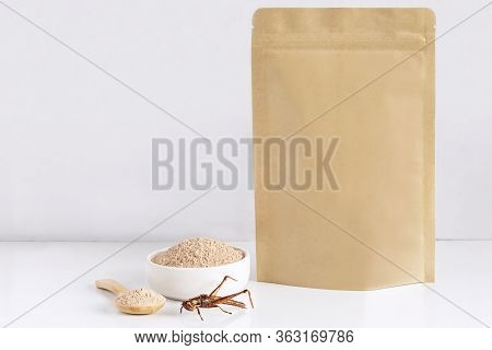 Grasshopper Insect Powder. Orthoptera Flour Processed From Insects Baked Food Is Eating Edible In Bo