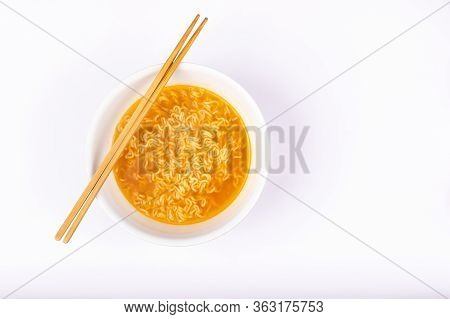 A Bowl Of Cooked Instant Noodle Curry Taste On White Background.