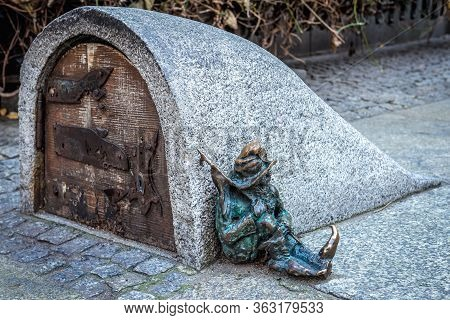 Wroclaw, Poland - December 2, 2019: Characteristic Dwarf Statuette In Front Of Garrison Church In Hi