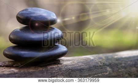 Stacked Massage Stones Stock Photo - Copy Spece. Spa Background Stock Photo - Baners.