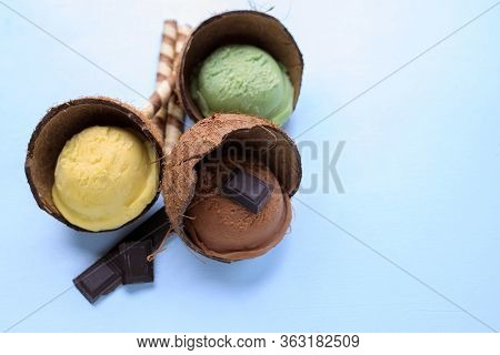 Vegetarian Sorbet Ice-cream Scoops In Coco Shell. Summer Background, Tropical Vacation Concept, Deli