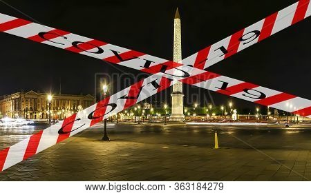 Coronavirus In Paris, France. Covid-19 Sign. Concept Of Covid Pandemic And Travel In Europe. Place D