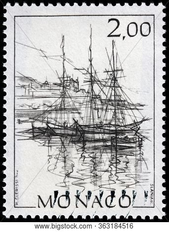 Luga, Russia - April 10, 2020: A Stamp Printed By Monaco Shows View Of Ships In The Monaco Harbor, C