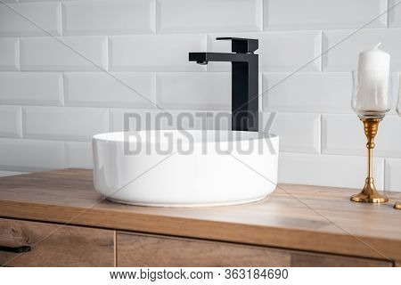 Black Faucet For Water And White Separate High Sink On Wooden Pedestal. Loft Style Bathroom