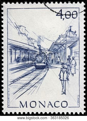 Luga, Russia - April 10, 2020: A Stamp Printed By Monaco Shows View Of Railroad Station In Monaco, M