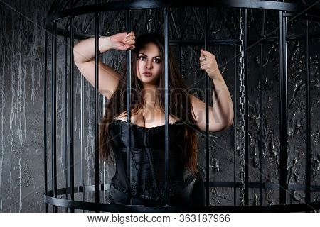 Plus Size Fashion Model In Sexy Clothes In A Steel Cage, Self Isolation Concept