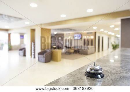 Hotel Reception Counter Desk. Focus On Service Bell