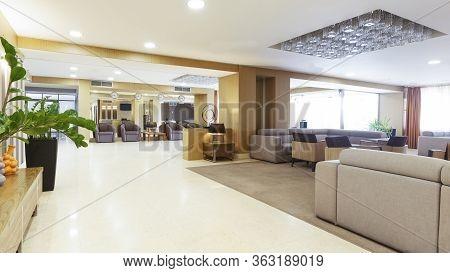 Interior Of Lobby Hotel Reception In Daytime, Nobody