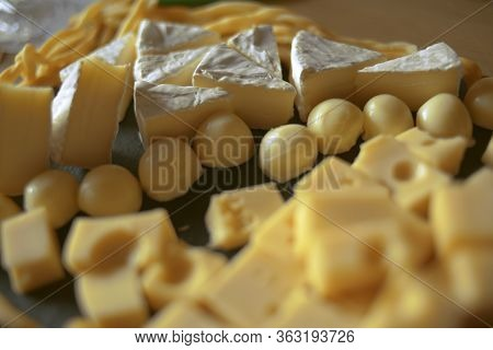 Cheese Cutting, Cheeses Of Different Types On A Black Background, Soy. Camembert, Hard Cheese, Pigta