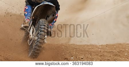 Motocross Racer Accelerating Speed In Track, Driving In The Motocross Race