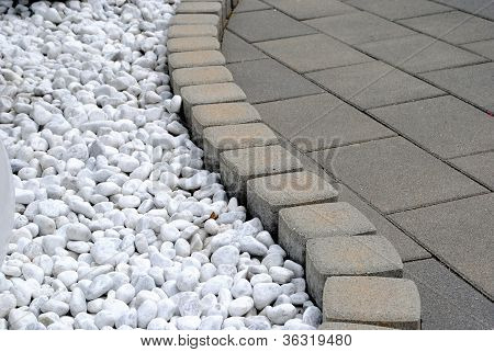 flower bed border made of pebbles and stones