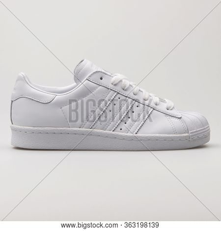Vienna, Austria - February 19, 2018: Adidas Superstar 80s Hh White And Red Sneaker On White Backgrou