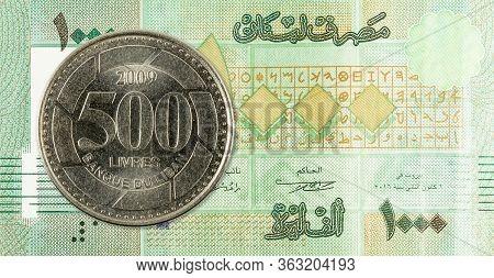 500 Lebanese Pound Coin Against 1000 Lebanese Pound Bank Note Obverse