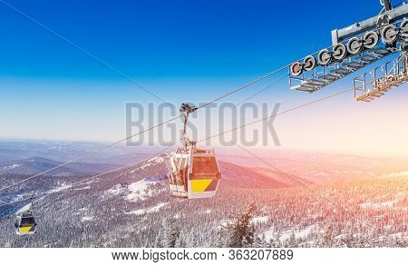 Cabin Lift For Sheregesh Kemerovo Ski Resort On Background Of Mountains And Blue Sky, Sunny Day
