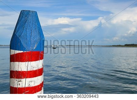 Pole For Mooring Boats In The Venice Lagoon Called Bricola In The Italian Language On The Blue Adria