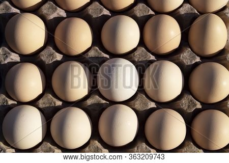 Flat Lay Close-up View Of Raw Chicken Eggs In Egg Paper Box.overhead View Of Brown Chicken Eggs In A