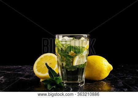 Fresh Bright Summer Cocktail. Mojito Cocktail With Lemon And Mint In A Glass On A Fashionable Stone
