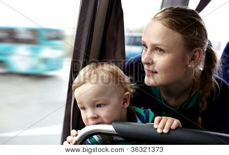 Mother and son travel by bus.