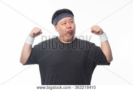 Asian Funny Fat Man In Sport Outfits Showing Strenght And Looking To Copyspace Isolated On White Bac