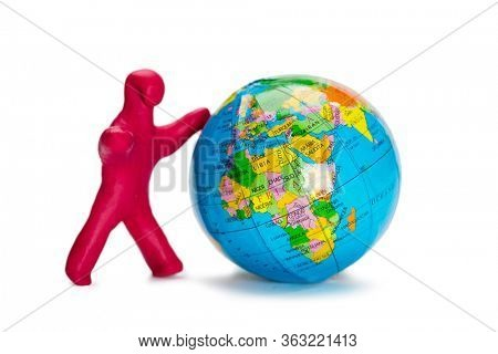Plasticine small person pushes the globe isolated on white