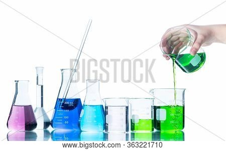 Put Green Liquid Into Measuring Beaker  With Laboratory Glassware And Liquids Of Different Colors, F