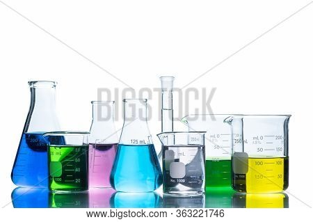 Laboratory Glassware With Liquids Of Different Colors, Flasks And Measuring Beaker For Science Exper