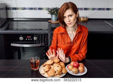 No Confectionery During Quarantine, Self-isolation. A Young Woman Refuses To Accept Unhealthy Cookie