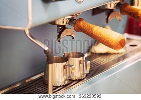 Coffee Machine. Coffee Machine Preparing Fresh Coffee And Pouring Into Two Cups At Restaurant, Bar O