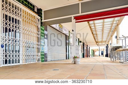 Orihuela, Spain - April 16, 2020: Closed Bars Restaurants Shopping Mall Commercial Area Due To Coron