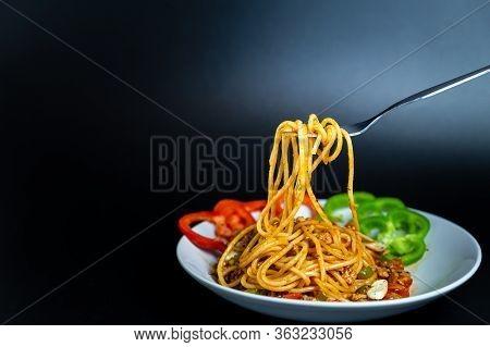 Delicious Spaghetti On Plate. Delicious Spaghetti With Tomato Sauce. Spaghetti Isolated On Black Bac