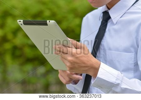 Businessman With A Tablet Pc In Hands.