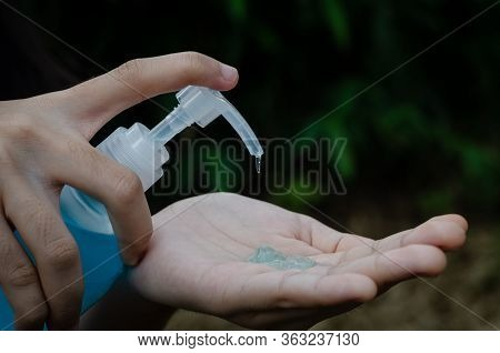 Woman Is Pouring Jel In Her Hand For Clean And Protect Herself From Virus Covid-19