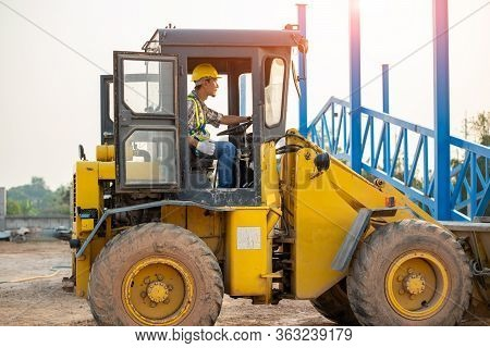 Engineer Drive Backhoe,excavator Loads Gravel In A Heavy Mining Truck,construction Concept.