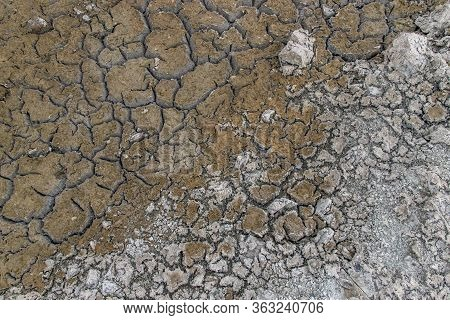A Barren Land That Is Shattered For Background And Textured. Drought From Global Warming. Ecology Co