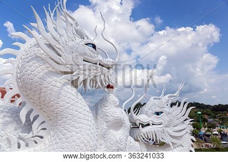 Dragon Statue With Blue Sky And Clouds Sky At Huay Pla Kang Temple, Chiangrai, Thailand. Aerial View