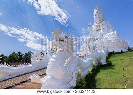 Guan Yin Statue And Dragon Statue With Blue Sky And Clouds Sky At Huay Pla Kang Temple, Chiangrai, T