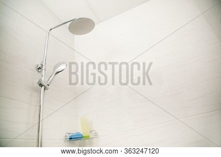Classic Shower Stall Trimmed With Beautiful White Porcelain Stoneware.