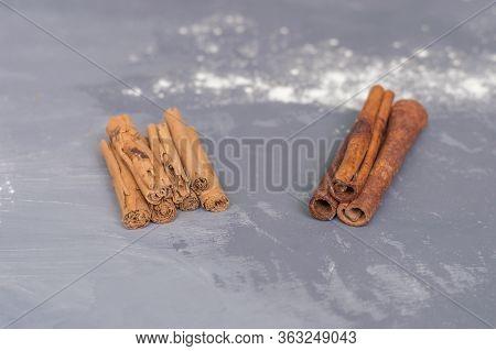 Chinese Cassia Originated From China And Ceylon Cinnamon Verum From Sri Lanka Bark Sticks On A Gray-