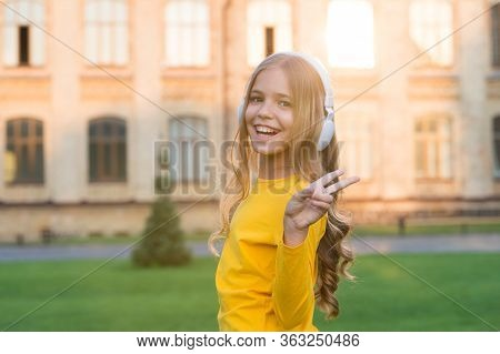 The Cool One. Cool Girl Wear Headphones Outdoors. Happy Child Listen To Music. Music Is Cool. Modern