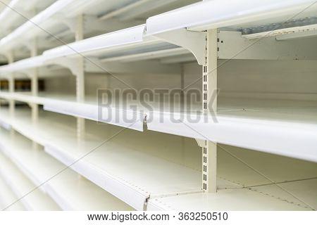 Shopping During Virus Outbreak. Empty Supermarket Shelves. Grocery Store. Pandemic. Coronavirus. The
