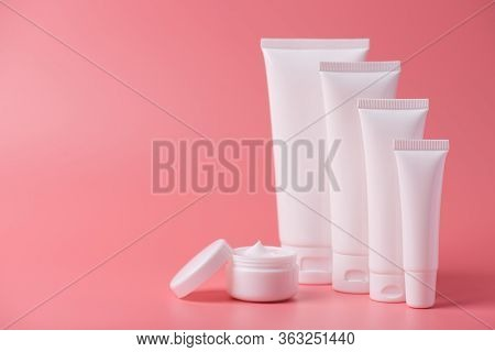 Body Pampering Advertisement Minimal Concept. Photo Of Set Of Container Box Creme With Open Round Ja