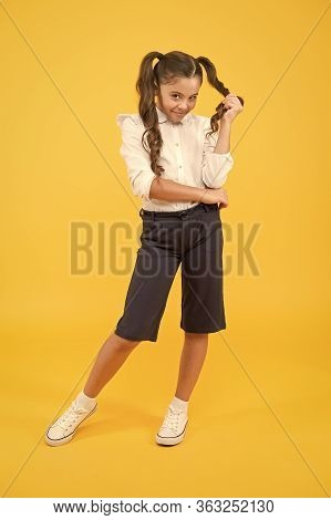 Playing With Hair. Schoolgirl Happy Smiling Pupil Long Hair. Beginning Of Academic Year. School Fash