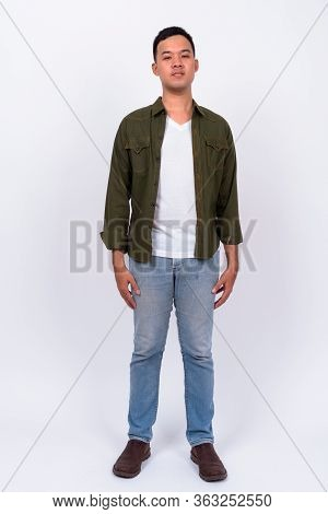 Full Body Shot Of Young Asian Man Wearing Jacket